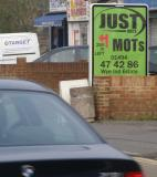 Directional Outdoor Advertising Poster for Just MOTs - 1.2m wide x 1.5m high, head on, solus panel on London Road, High Wycombe. Huge target audience