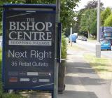 Directional Sign for Land Securities plc Advertising The Bishop Centre on the A4 Bath Road between Slough and Maidenhead