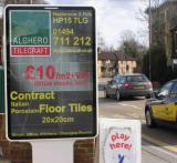 "Special Offer Poster - ""6 sheet"" 1.2m wide x 1.8m high - very busy, head on site with two lanes of slow moving traffic, approaching traffic lights on London Road High Wycombe"
